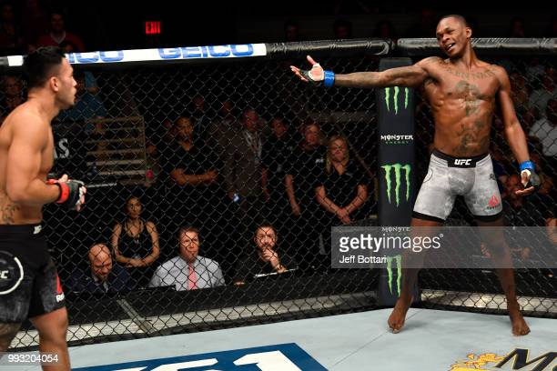Israel Adesanya of Nigeria taunts Brad Tavares in their middleweight bout during The Ultimate Fighter Finale event inside The Pearl concert theater...