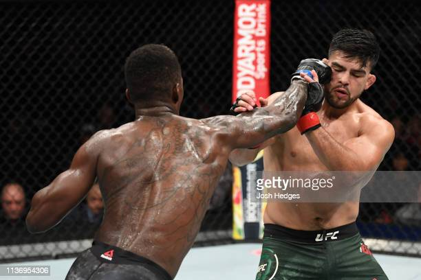 Israel Adesanya punches Kelvin Gastelum in their interim middleweight championship bout during the UFC 236 event at State Farm Arena on April 13 2019...