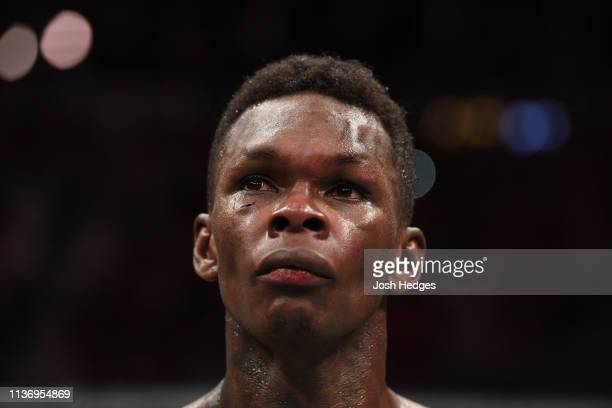 Israel Adesanya reacts after defeating Kelvin Gastelum by unanimous decision in their interim middleweight championship bout during the UFC 236 event...