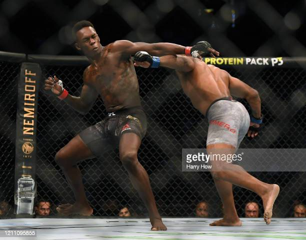 Israel Adesanya reacts to a punch from Yoel Romero in a Adesanya decision win to retain the middleweight title at TMobile Arena on March 07 2020 in...