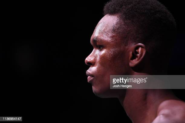 Israel Adesanya stands in his corner prior to facing Kelvin Gastelum in their interim middleweight championship bout during the UFC 236 event at...