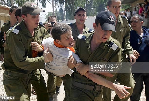 An Israeli soldiers acting as a resisting settler is being carry on by Israeli policemen trying to evacuate him from his home during a largescale...
