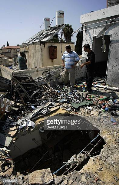Asher Akuka returns to his house with an insurance assessor to inspect the damage caused when a rocket fired by Hezbullah guerillas smashed into his...