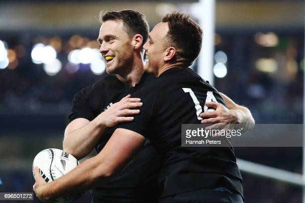 Israel Dagg celebrates with Ben Smith of the All Blacks after scoring a try during the International Test match between the New Zealand All Blacks...