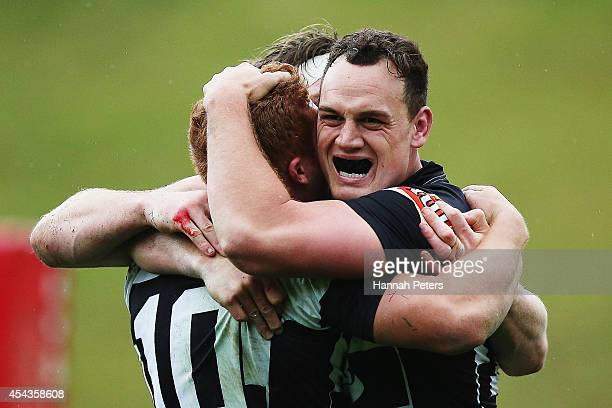 Israel Dagg celebrates with Ihaia West and Brendon O'Connor of the Hawke's Bay Magpies after winning the ITM Cup rugby game between the Counties...