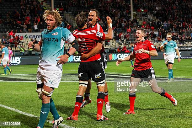 Israel Dagg celebrates with Sam Whitelock both of the Crusaders after scoring a try during the round six Super Rugby match between the Crusaders and...