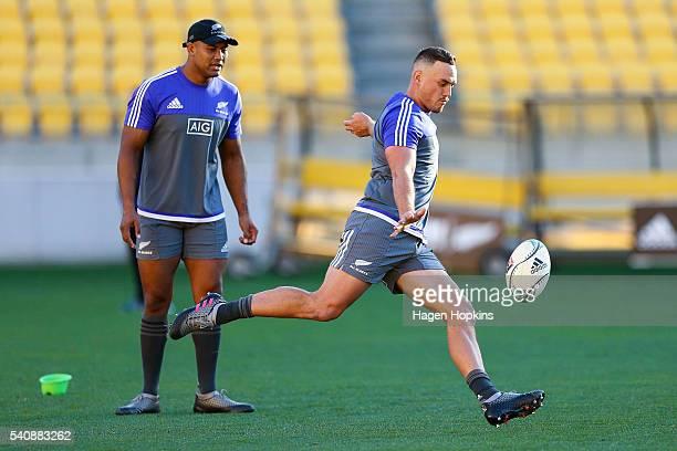 Israel Dagg kicks while Julian Savea looks on during a New Zealand All Blacks Captain's Run at Westpac Stadium on June 17 2016 in Wellington New...