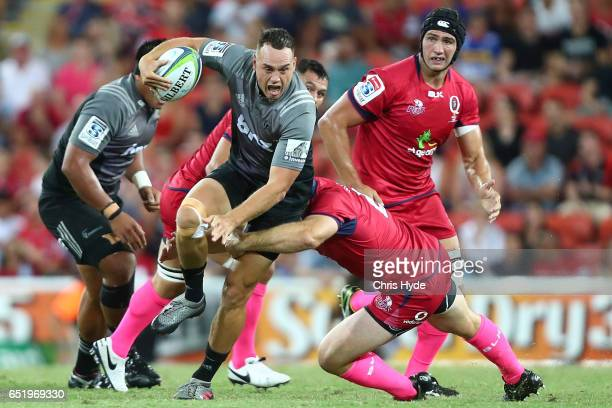 Israel Dagg of Crusaders runs the ball during the round three Super Rugby match between the Reds and the Crusaders at Suncorp Stadium on March 11...