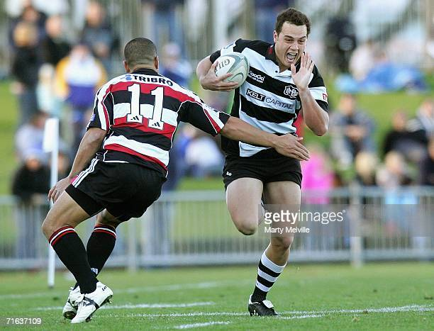 Israel Dagg of Hawkes Bay gets tackled by Tevita Tuifua of Counties Manukau during the Air New Zealand Cup match between the Hawkes Bay Magpies and...