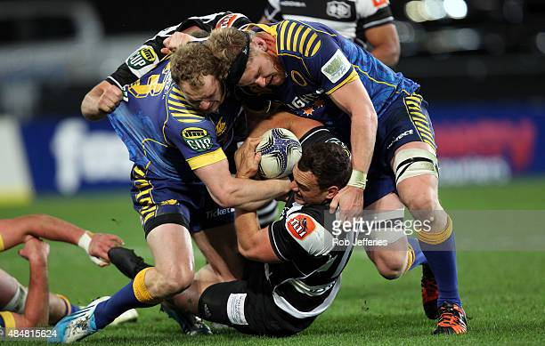 Israel Dagg of Hawke's Bay is hit in a heavy tackle by Matt Faddes and Josh Dickson of Otago during the round two ITM Cup match between Otago and...