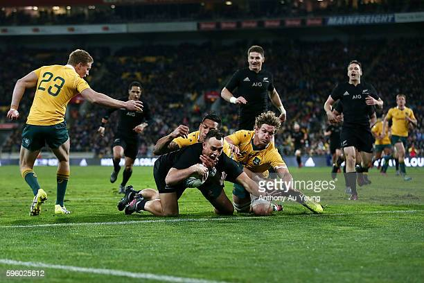 Israel Dagg of New Zealand scores a try against Israel Folau and Michael Hooper of Australia during the Bledisloe Cup Rugby Championship match...