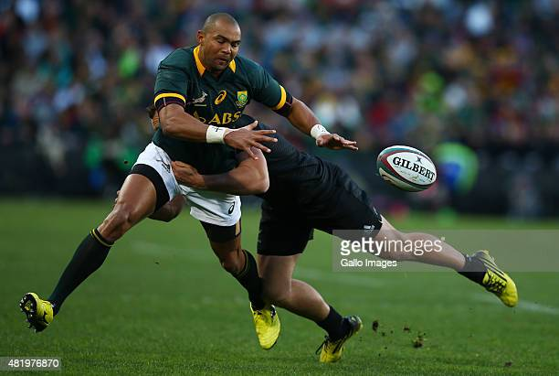 Israel Dagg of New Zealand with a big tackle on Cornal Hendricks of South Africa during The Castle Lager Rugby Championship 2015 match between South...