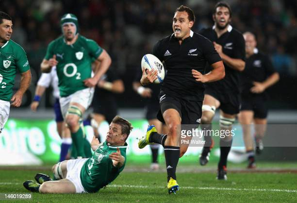 Israel Dagg of the All Blacks breaks through the tackle of Brian O'Driscoll of Ireland during the International Test Match between the New Zealand...