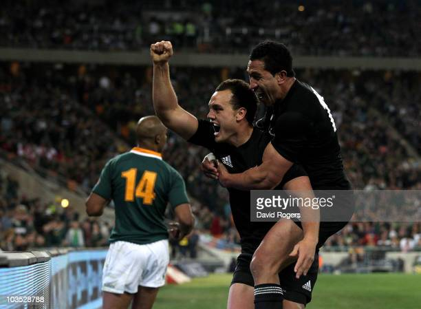 Israel Dagg of the All Blacks celebrates with team mate Mils Muliaina after scoring the match winning try during the 2010 TriNations match between...
