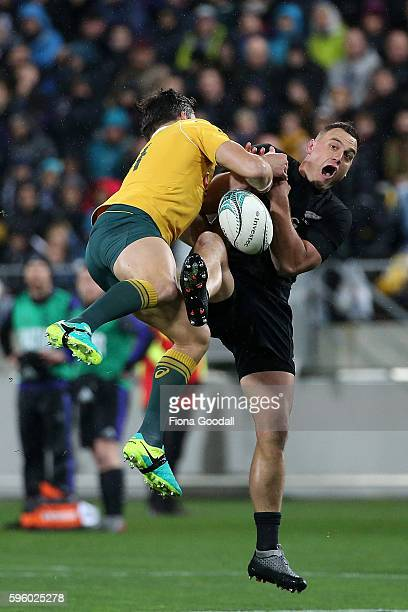 Israel Dagg of the All Blacks challenges Adam AshleyCooper of the Wallabies to the high ball during the Bledisloe Cup Rugby Championship match...