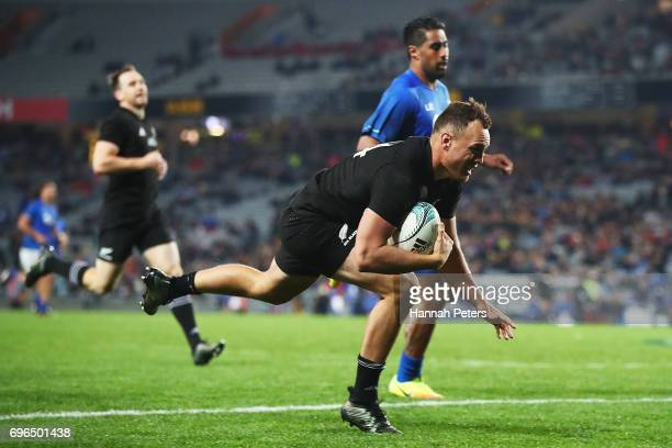 Israel Dagg of the All Blacks dives over to score a try during the International Test match between the New Zealand All Blacks and Samoa at Eden Park...