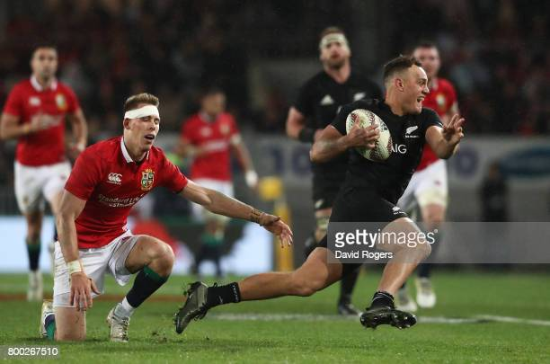 Israel Dagg of the All Blacks evades Liam Williams of the Lions during the first test match between the New Zealand All Blacks and the British Irish...
