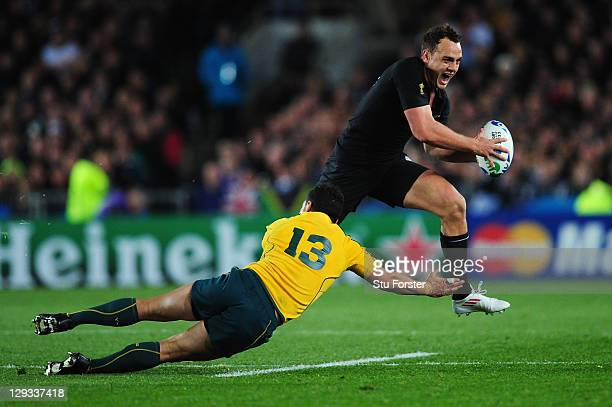 Israel Dagg of the All Blacks evades the challenge of Anthony Fainga'a of the Wallabies during semi final two of the 2011 IRB Rugby World Cup between...