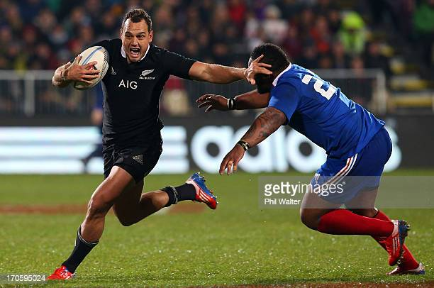 Israel Dagg of the All Blacks is tackled by Mathieu Bastareaud of France during the International Test match between the New Zealand All Blacks and...