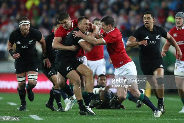 Israel Dagg of the All Blacks is wrapped up by Owen Farrell and Johnny Sexton of the Lions during the second test match between the New Zealand All...