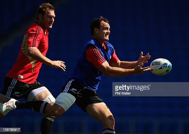 Israel Dagg of the All Blacks passes watched by Ali Williams during a New Zealand All Blacks training session at Trusts Stadium on October 21 2011 in...