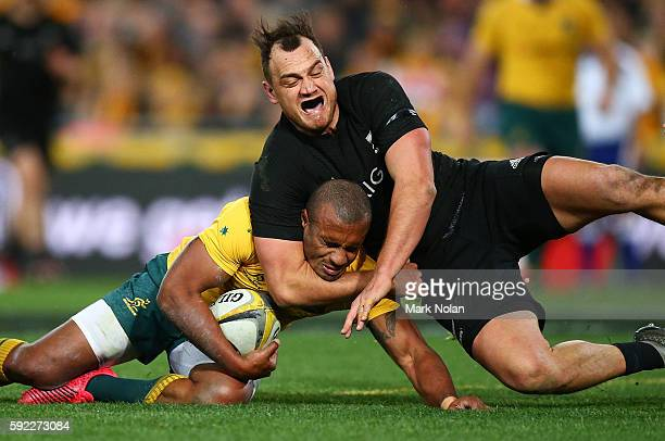Israel Dagg of the All Blacks tackles Will Genia of the Wallabies during the Bledisloe Cup Rugby Championship match between the Australian Wallabies...
