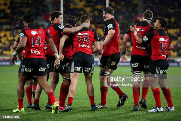 Israel Dagg of the Crusaders celebrates his try with David Havili Matt Todd and Scott Barrett during the round 17 Super Rugby match between the...