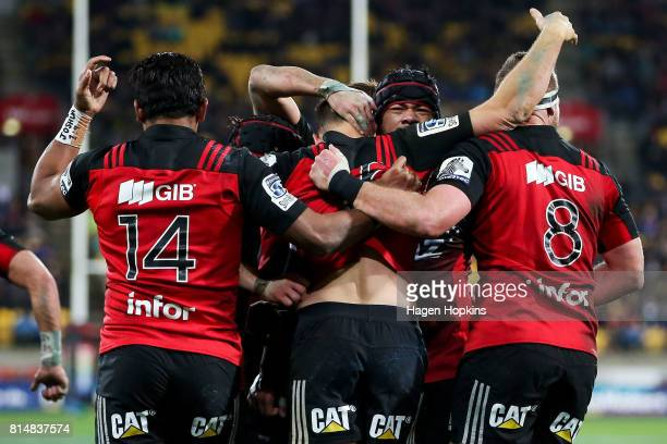 Israel Dagg of the Crusaders celebrates his try with Jordan Taufua during the round 17 Super Rugby match between the Hurricanes and the Crusaders at...