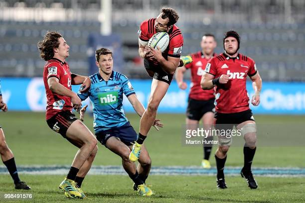 Israel Dagg of the Crusaders controls the ball during the round 19 Super Rugby match between the Crusaders and the Blues at AMI Stadium on July 14...