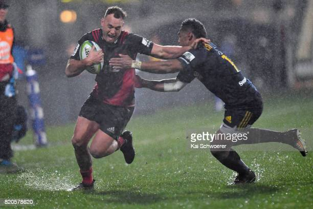 Israel Dagg of the Crusaders is tackled by Waisake Naholo of the Highlanders during the Super Rugby Quarter Final match between the Crusaders and the...
