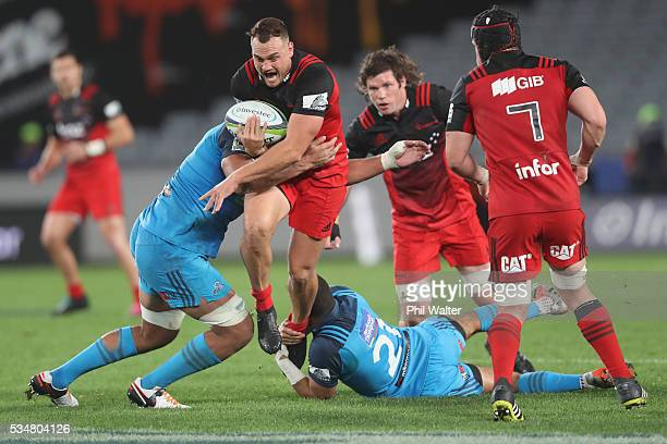 Israel Dagg of the Crusaders is tackled during the round 14 Super Rugby match between the Blues and the Crusaders at Eden Park on May 28 2016 in...