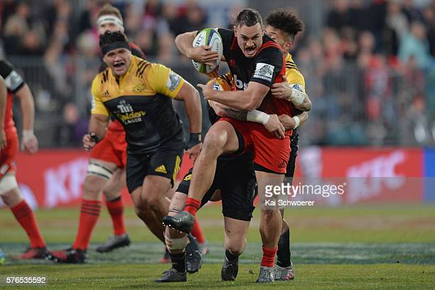 Israel Dagg of the Crusaders is tackled during the round 17 Super Rugby match between the Crusaders and the Hurricanes at AMI Stadium on July 16 2016...