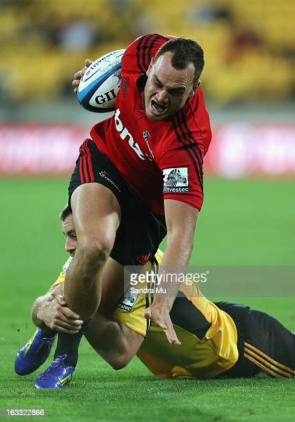 Israel Dagg of the Crusaders is tackled during the round four Super Rugby match between the Hurricanes and the Crusaders at Wellington Regional...