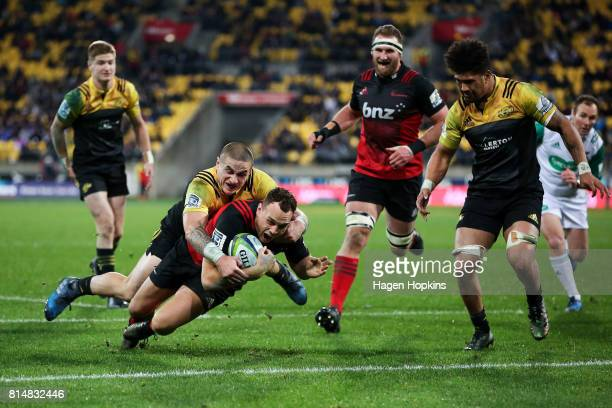 Israel Dagg of the Crusaders scores a try in the tackle of TJ Perenara of the Hurricanes during the round 17 Super Rugby match between the Hurricanes...