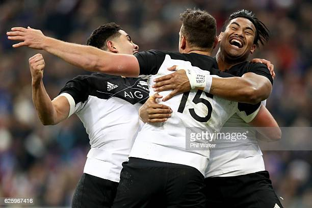 Israel Dagg of the New Zealand All Blacks celebrates his try with Anton LeinertBrown and Julian Savea during the international rugby match between...