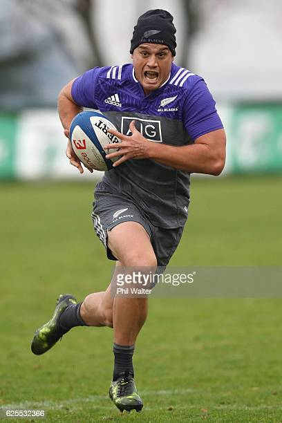 Israel Dagg of the New Zealand All Blacks runs with the ball during a training session at the Suresnois Rugby Club on November 24 2016 in Paris France