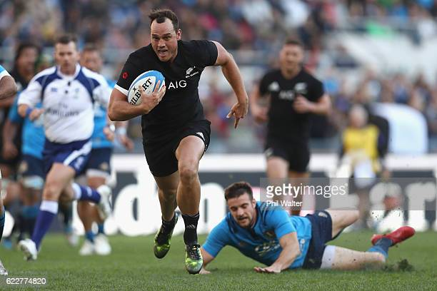 Israel Dagg of the New Zealand All Blacks scores a try during the international rugby match between New Zealand and Italy at Stadio Olimpico on...