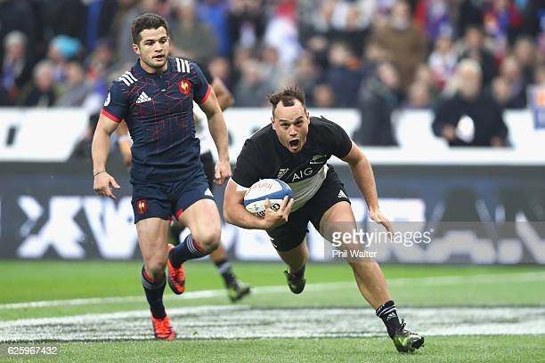 Israel Dagg of the New Zealand All Blacks scores the opening try during the international rugby match between France and New Zealand at Stade de...