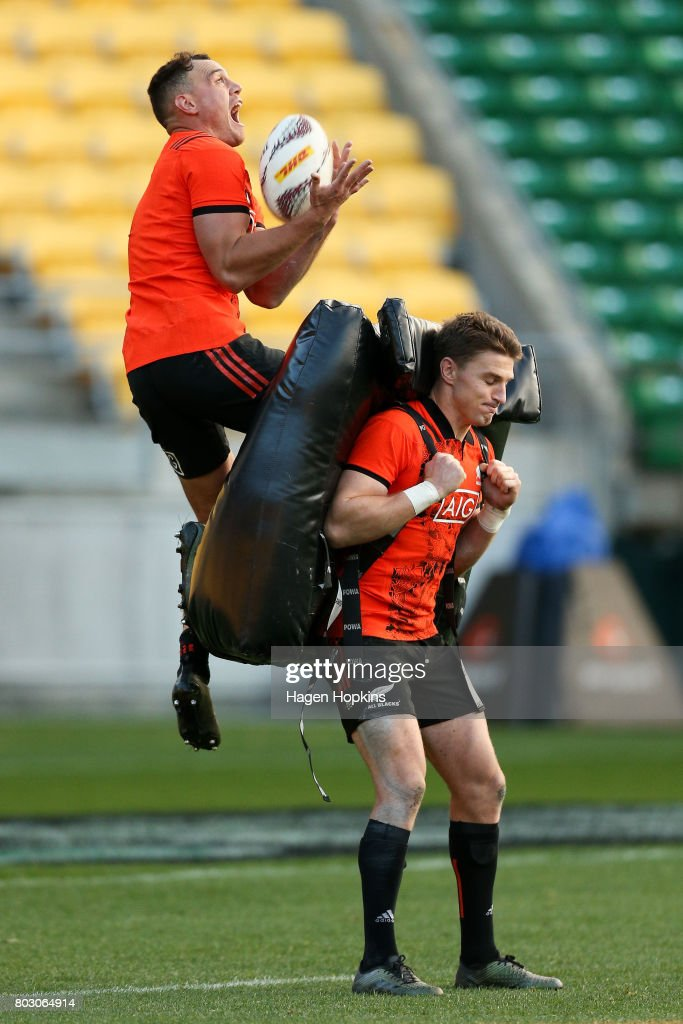 Israel Dagg takes a high ball on with help from Beauden Barrett during a New Zealand All Blacks training session at Westpac Stadium on June 29, 2017 in Wellington, New Zealand.