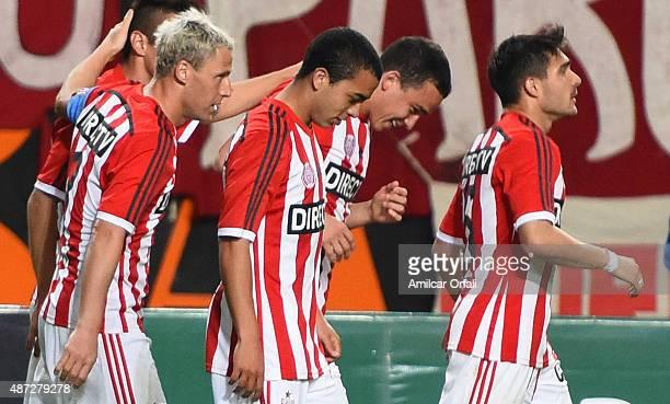 Israel Damonte Lucas Rodriguez Leonardo Jara and Ezequiel Cerutti celebrate the own goal scored by Roger Martinez of Aldosivi during a match between...