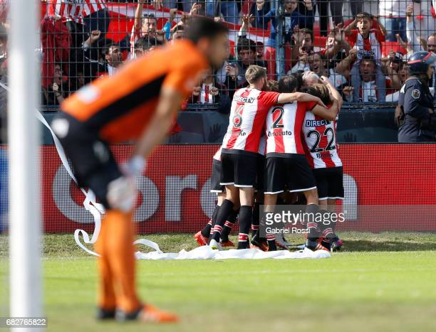 Israel Damonte of Estudiantes celebrates with teammates after scoring the first goal of his team during a match between Estudiantes and Gimnasia y...