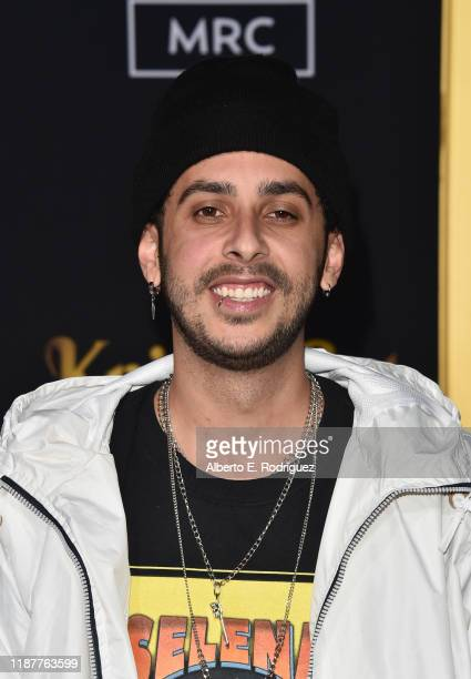 Israel De Corcho attends the premiere of Lionsgate's Knives Out at Regency Village Theatre on November 14 2019 in Westwood California