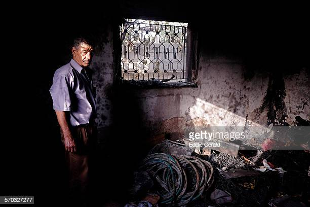 Israel Duma village West Bank 02 August 2015 Palestinian man stand inside the burned house of Dawabsha family which was firebombed by masked...