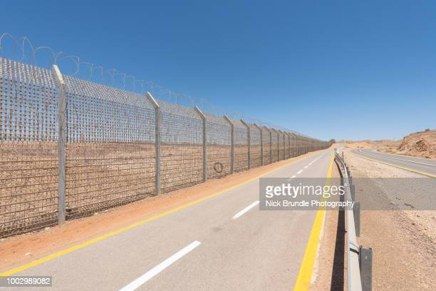 israel egypt border fence in the negev, israel - national border stock pictures, royalty-free photos & images