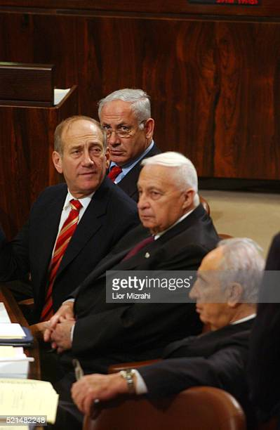 Israel Finance Minister Benjamin Netanyahu Vice Premier Ehud Olmert Prime Minister Ariel Sharon and Vice Premier Shimon Peres are seen during the...