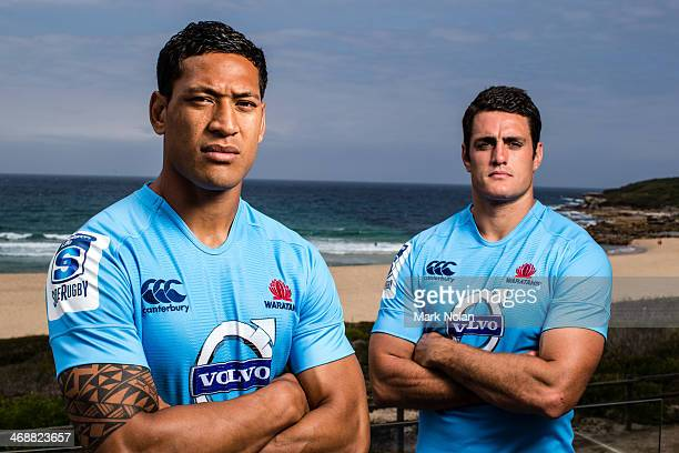 Israel Folau and Dave Dennis of the Waratahs pose for photos during the Australian Super Rugby season launch at Horizons South Maroubra beach on...