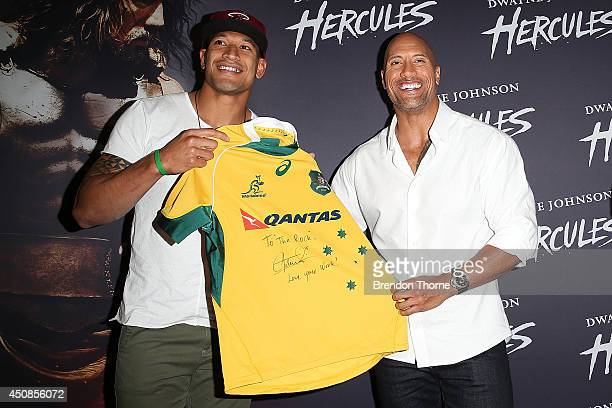 Israel Folau and Dwayne Johnson arrives at the screening of HERCULES at Event Cinemas George Street on June 19 2014 in Sydney Australia
