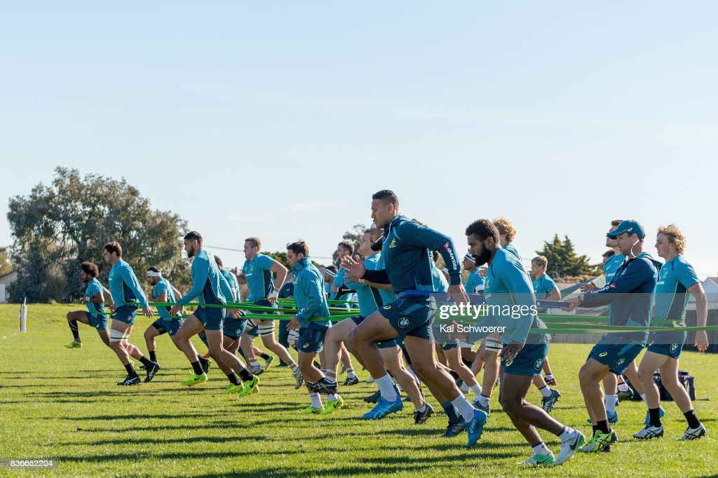 Israel Folau (C) and his team mates run during resistance training at an Australian Wallabies training session at Linwood Rugby Club on August 22, 2017 in Christchurch, New Zealand.