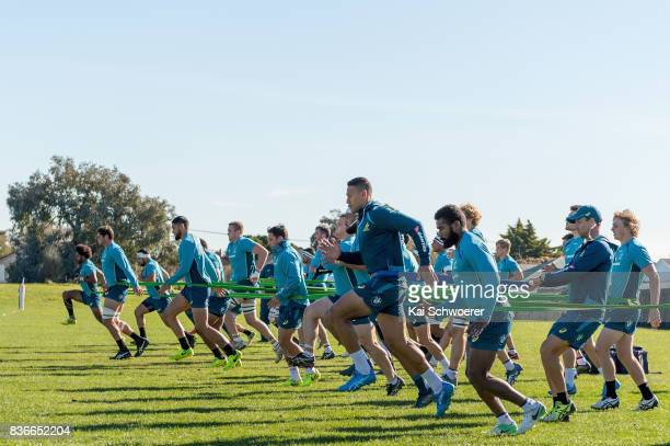 Israel Folau and his team mates run during resistance training at an Australian Wallabies training session at Linwood Rugby Club on August 22 2017 in...