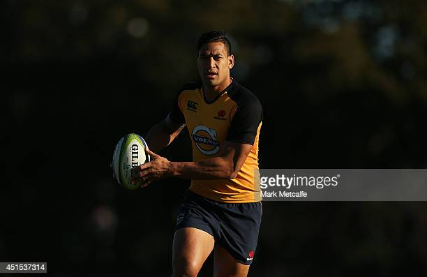 Israel Folau in action during a Waratahs Super Rugby training session at Kippax Lake on July 1 2014 in Sydney Australia
